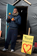 France , Calais, camp for refugees known as 'The Jungle'. November 2015. An Afghan man juggles oranges at the entrance to the 'Therapy Community Space'.