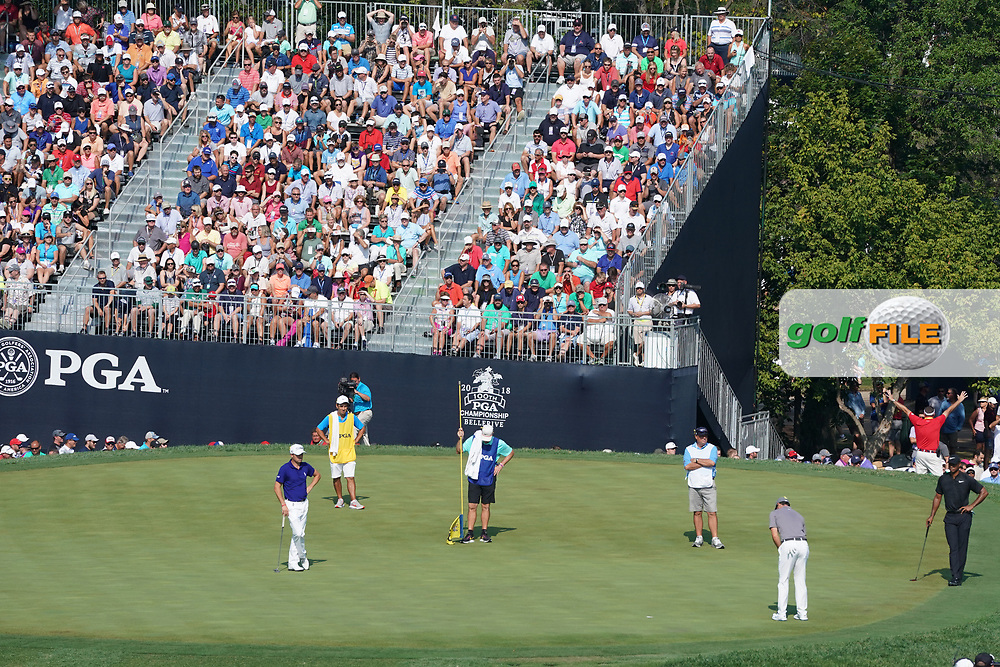 Rory McIlroy (NIR) and Justin Thomas (USA) and Tiger Woods (USA) putt on the 18th hole during the second round of the 100th PGA Championship at Bellerive Country Club, St. Louis, Missouri, USA. 8/11/2018.<br /> Picture: Golffile.ie | Brian Spurlock<br /> <br /> All photo usage must carry mandatory copyright credit (© Golffile | Brian Spurlock)