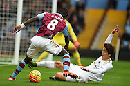 Idrissa Gana of Aston Villa tries to go past Swansea city's Ki Sung-Yueng. Barclays Premier league match, Aston Villa v Swansea city at Villa Park in Birmingham, the Midlands on Saturday 24th October 2015.<br /> pic by  Andrew Orchard, Andrew Orchard sports photography.
