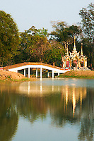 Bridge at Wat Phra Ram at Ayutthya, reflecting on the waters within the grounds of Ayutthaya Historical Park, listed as a UNESCO world heritage site in 1991.
