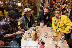 Mooneyes' Shige Suganuma with guests at the Monday night afterparty at Mooneyes Area One after the Mooneyes Yokohama Hot Rod & Custom Show. Yokohama, Japan. December 5, 2016.  Photography ©2016 Michael Lichter.
