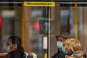 Following the government decision to reopen Britain, the picture shows people wearing face-covering masks whilst using public transport to move around in the city of Manchester, England on Wednesday, April 28, 2021. Manchester is part of the UK to lift some of the restrictions designed to stop the spread of Covid-19. (Photo/ Vudi Xhymshiti)