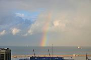 Israel, Haifa, a rainbow over the port. The rainbow's end is in the mediterranean sea