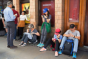 Line of people all using their mobile devices in London, England, United Kingdom. (photo by Mike Kemp/In Pictures via Getty Images)