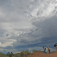 Photographers frame dramatic clouds above Ghost Ranch, near Abiquiu, New Mexico.