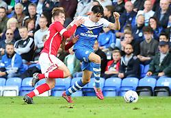 Peterborough United's Joe Newell in action with Barnsley's James Bree - Photo mandatory by-line: Joe Dent/JMP - Mobile: 07966 386802 - 18/10/2014 - SPORT - Football - Peterborough - London Road Stadium - Peterborough United v Barnsley - Sky Bet League One