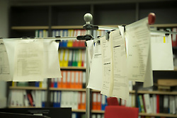 Order forms hanging in office, Munich, Bavaria, Germany