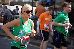 Virgin London Marathon 2013..Celebrity runners. Soprano singer Katherine Jenkins at the 21 mile marker, April 21, 2013. Photo by: Gavin Rodgers / i-Images