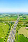 Nederland, Gelderland, Gemeente Zaltbommel, 23-08-2016; verkeersknooppunt Deil, A2 en A15 (vlnr). Parallel aan de A2 de Betuweroute, foto in Noordelijk richting. Klaverturbineknooppunt.<br /> Deil junction, main motorway A15 (Rotterdam Harbour - Germany) crossing motorway A2 to the South.<br /> <br /> aerial photo (additional fee required); luchtfoto (toeslag op standard tarieven); copyright foto/photo Siebe Swart