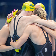 TOKYO, JAPAN - JULY 25: The Australian team of Bronte Campbell, Cate Campbell, Meg Harris and Emma Mckeon celebrate the Australian teams gold medal world record performance in the 4 x 100m Freestyle Relay for women during the Swimming Finals at the Tokyo Aquatic Centre at the Tokyo 2020 Summer Olympic Games on July 25, 2021 in Tokyo, Japan. (Photo by Tim Clayton/Corbis via Getty Images)