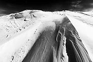 Heavy wind on the peak ridge of Piz Grevasalvas, Bivio, Parc Ela, Grisons, Switzerland