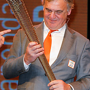 NLD/Arnhem/20121103 - 100 Jarig bestaan NOC/NSF Sportparade, Andre Bolhuis met de Olympische  fakkel van de O.S. 2012 Londen