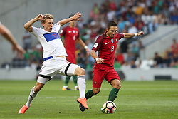 August 31, 2017 - Porto, Portugal - Portugal's midfielder Joao Moutinho (R ) vies with Faroe Islands' forward Joan Edmundsson during the 2018 FIFA World Cup qualifying football match between Portugal and Faroe Islands at the Bessa XXI stadium in Porto, Portugal on August 31, 2017. (Credit Image: © Pedro Fiuza/NurPhoto via ZUMA Press)
