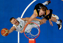 Rimantas Kaukenas of Lithuania vs Robin Benzing of Germany  during basketball game between National basketball teams of Lithuania and Germany at FIBA Europe Eurobasket Lithuania 2011, on September 11, 2011, in Siemens Arena,  Vilnius, Lithuania. Lithuania defeaed Germany 84-75. (Photo by Vid Ponikvar / Sportida)