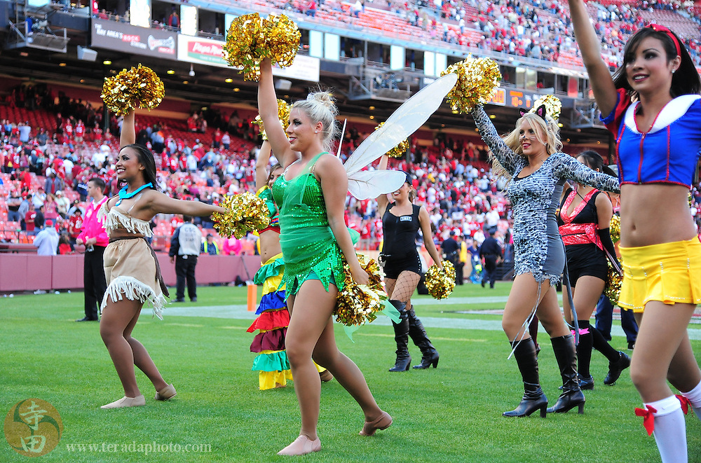 October 30, 2011; San Francisco, CA, USA; San Francisco 49ers Gold Rush cheerleaders (L-R) Tyesha, Amy, Ali, and Aleena perform in halloween costumes during the fourth quarter against the Cleveland Browns at Candlestick Park. The 49ers defeated the Browns 20-10.