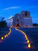 Luminarios on Christmas Eve leading to the mission church San Jose de Tumacacori, Tumacacori National Historical Park, Arizona.