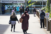 A woman wearing niqab and face protective mask is seen leaving St Thomas' Hospital in London on Tuesday, May 5, 2020. The BAME community makes up of 10.8% of the population in Britain, but 34.5% of critically ill coronavirus patients, according to local media are from BAME community. (Photo/Vudi Xhymshiti)