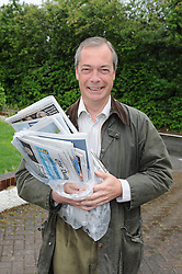 ***LNP HIGHLIGHTS OF THE WEEK 30/05/14***<br /> <br /> **Exclusive pictures** @ London News Pictures. 24/05/2014. UKIP leader Nigel Farage arriving back at his home in Kent today (SAT) after buying the newspapers on the eve of the European Election results. All of the papers have reported on the UK Independence Party's local election success. Photo credit: Grant Falvey/LNP