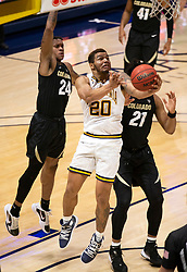 Feb 13, 2021; Berkeley, California, USA; California Golden Bears guard Matt Bradley (20) goes up for a layup ahead of Colorado Buffaloes defenders Eli Parquet (24) and Evan Battey (21)during the first half of an NCAA basketball game at Haas Pavilion. Mandatory Credit: D. Ross Cameron-USA TODAY Sports