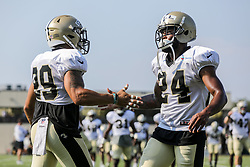 July 28, 2018 - New Orleans, LA, U.S. - METAIRIE, LA. - JULY 28: New Orleans Saints defensive back Kurt Coleman (29) and defensive back Vonn Bell (24) warm up during the New Orleans Saints training camp practice on July 28, 2018 at the Ochsner Sports Performance Center in New Orleans, LA.  (Photo by Stephen Lew/Icon Sportswire) (Credit Image: © Stephen Lew/Icon SMI via ZUMA Press)