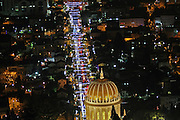 Israel, Haifa, The city is lit up with Christmas decorations Photogrphaed December 17th 2015 The Bahai temple in the foreground