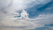 Blue desert sky background with light high, white, feather clouds Photographed in the Negev Desert, Israel in February