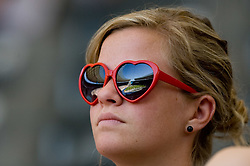 Girl watching the men's pole vault qualifying event  during day six of the 12th IAAF World Athletics Championships at the Olympic Stadium on August 20, 2009 in Berlin, Germany. (Photo by Vid Ponikvar / Sportida)