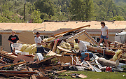 Amaber and Floyd Terry, left, pick through debris with Gordon Richardson, his daughter Michelle Tate, and his wife Becky Richardson Monday, May 31, 2004, in Marengo, Ind., after a tornado struck Sunday, killing one and injuring four. Michelle Tate's mobile home was lifted by the storm and dropped on the Terry's mobile home. Neither f the families were home when the tornado struck. (AP Photo/Brian Bohannon)