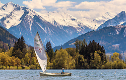 THEMENBILD - ein Mann mit einem Segelboot, aufgenommen am 30. April 2016, am Zeller See, Zell am See, Oesterreich // a man on a sailboat at the Lake Zell, Zell am See, Austria on 2016/04/30. EXPA Pictures © 2016, PhotoCredit: EXPA/ JFK