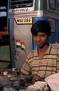 Indian boy selling snacks in Calcutta bus station, The Maidan