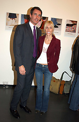 ALEXANDRA VON FURSTENBURG who is separated from her husband Austrian Prince Alexander von Furstenberg and TIM JEFFERIES at an exhibition of photographs by Matthew Mellon entitled Famous Feet - featuring well known people wearing shoes from Harrys of London, held at Hamiltons Gallery, Carlos Place, London on 22nd November 2004.<br /><br />NON EXCLUSIVE - WORLD RIGHTS