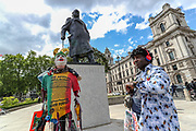 The resemblance of the US President Donald Trump appears to be standing beside former British PM Winston Churchill statue, as anti-racism demonstrators organised by the Black Lives Matter movement held the fourth weekend of protests in Central London, on Sunday, June 21, 2020. Anger against systemic levels of institutional racism have raged through the city, and worldwide; sparked by the death of George Floyd in the United States last month. (Photo/ Vudi Xhymshiti)