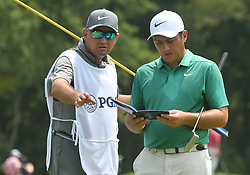 August 12, 2018 - St. Louis, Missouri, U.S. - ST. LOUIS, MO - AUGUST 12: Francesco Molinari's caddie offers suggestions on how to play the #2 hole during the final round of the PGA Championship on August 12, 2018, at Bellerive Country Club, St. Louis, MO.  (Photo by Keith Gillett/Icon Sportswire) (Credit Image: © Keith Gillett/Icon SMI via ZUMA Press)