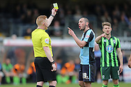 Referee Alan Young gives a Yellow card to Michael Harriman of Wycombe Wanderers. Skybet football league two match, Wycombe Wanderers  v AFC Wimbledon at Adams Park  in High Wycombe, Buckinghamshire on Saturday 2nd April 2016.<br /> pic by John Patrick Fletcher, Andrew Orchard sports photography.