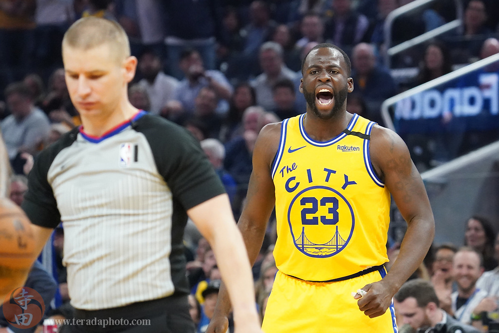 February 27, 2020; San Francisco, California, USA; Golden State Warriors forward Draymond Green (23) argues after being ejected by NBA official Tyler Ford (left) against the Los Angeles Lakers during the second quarter at Chase Center.