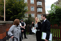 © Licensed to London News Pictures. 05/05/2013. London, UK. Detectives question locals in front of the scene where a 30 year-old man was stabbed to death at a flat in Jessam Avenue, Clapton, east London, on Saturday night.Two men have been arrested on suspicion of murder. Photo credit : Peter Kollanyi/LNP