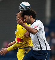 Photo: Steve Bond/Richard Lane Photography. Preston North End v Cardiff City. Coca Cola Championship. 27/02/2010. Youl Mawene (R) gets the better of Jay Bothroyd (L)