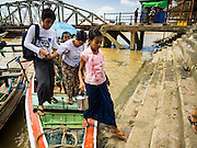 22 OCTOBER 2015 - YANGON, MYANMAR:    Passengers get off a cross river ferry on the Yangon side of the Yangon river. The ferries, which charge passengers a few cents per trip, are an important part of the Yangon transportation system.  PHOTO BY JACK KURTZ