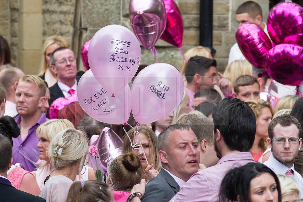 © Licensed to London News Pictures . 09/08/2013 . Salford , UK . Mourners carry balloons with messages outside the church , after the service . The funeral of Linzi Ashton at St Paul's C of E Church in Salford , today (9th August 2013) . Linzi Ashton (25) was found murdered in her home on Westbourne Road in Salford on 29th June . Michael Cope is standing trial, accused of murdering, raping and assaulting her . Photo credit : Joel Goodman/LNP