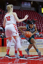 10 December 2017: Danielle Minott cuts around Mille Stevens during an College Women's Basketball game between Illinois State University Redbirds and the Eagles of Eastern Michigan at Redbird Arena in Normal Illinois.