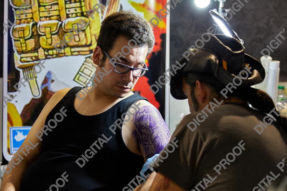 Milan, Italy - March 8 2019 Cartoomics Comic Con a Tattoo Artist at work