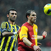 Galatasaray's Johan Elmander (R) and Fenerbahce's Selcuk Sahin (L) during their Turkish superleague soccer derby match Galatasaray between Fenerbahce at the TT Arena in Istanbul Turkey on Friday, 18 March 2011. Photo by TURKPIX
