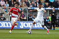 Luciano Narsingh of Swansea city goes past Fabio of Middlesbrough (l). Premier league match, Swansea city v Middlesbrough at the Liberty Stadium in Swansea, South Wales on Sunday 2nd April 2017.<br /> pic by Andrew Orchard, Andrew Orchard sports photography.