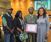 Trustee Rhonda Skillern-Jones presents a recognition to Atherton Elementary School principal Albert Lemons during a meeting of the Houston ISD Board of Trustees, April 14, 2016.