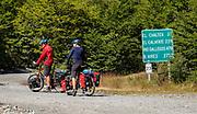 Bicycle tourists on gravel road RP23 at Lago del Desierto, north of El Chalten in Santa Cruz Province, Argentina, Patagonia, South America.