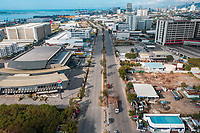 MANDAUE, PHILIPPINES - APRIL 10 2020: An aerial view of a nearly empty business district in North Reclamation Area, Mandaue City, Cebu, Philippines.