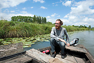Rémy Colin, traditional boat maker from Saint-Omer, in the Audomarois (marshes) of Saint-Omer, Pas-de-Calais, France © Rudolf Abraham