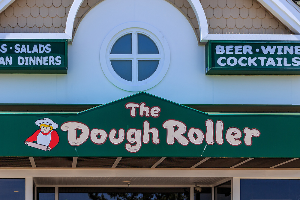 Ocean City, MD, USA - May 26, 2018: The Dough Roller Pizza Restaurant is a popular eatery in the summer on the Ocean City boardwalk.