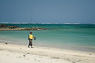 Indonesia, Lombok. A fisherman on Kuta Beach. He's coming home late in the afternoon.