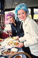 Amanda Holden being served food in the mobile kitchen during filming The Grimleys near Manchester
